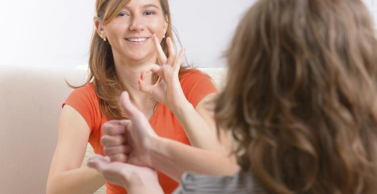 Two young women using sign language
