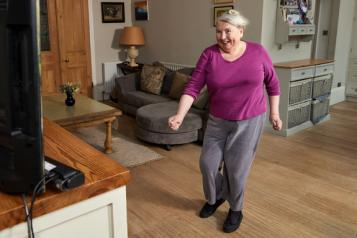 Older lady exercising at home