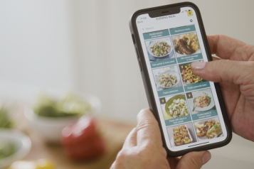 app on phone with healthy recipes