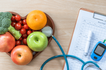 diabetes kit and heart shaped fruit