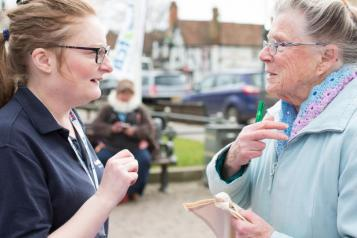 person talking to member of Healthwatch staff
