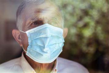 older man wearing a face mask