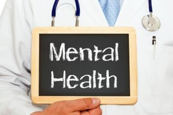 GP holding a mental health sign