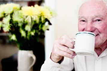 Older man having a coffee