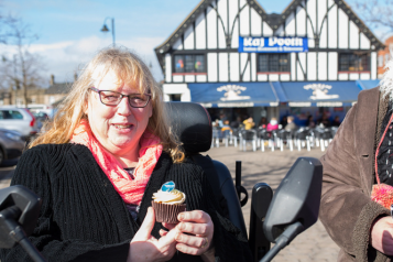 lady in a wheelchair with a cupcake