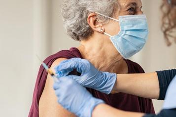older lady having vaccine