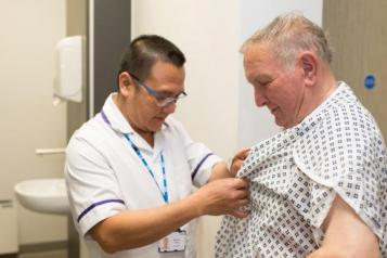 man and health care assistant