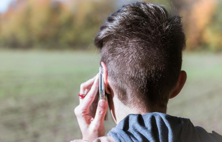 A picture of a person making a call on a mobile phone